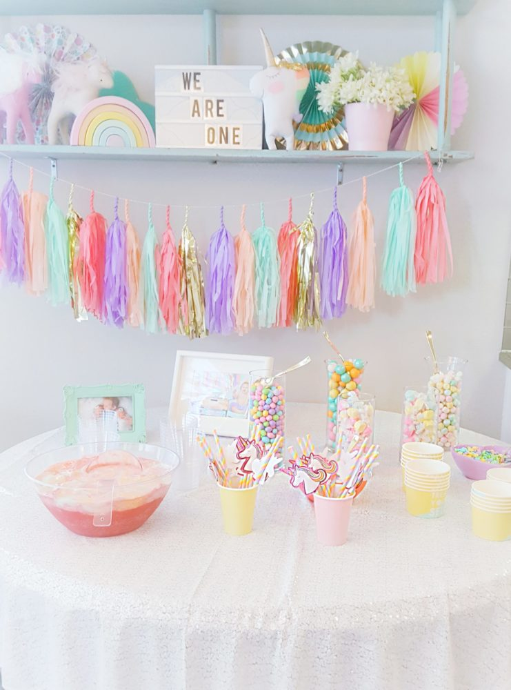 A pretty pastel unicorn first birthday party including pastel unicorn tassel garland rainbow punch pastel unicorn candy bar and many more unicorn centerpiece ideas and unicorn backdrop ideas for unicorn party ideas on a budget