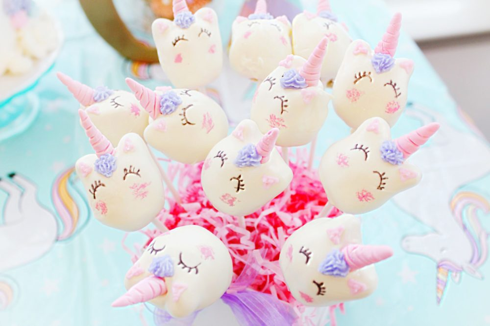 A pretty pastel unicorn first birthday party with unicorn cake, unicorn cupcakes, and unicorn cake pops. Everything you need for unicorn 1st birthday party decorations