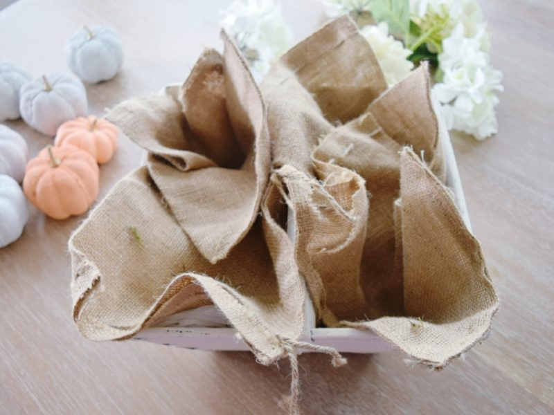 DIY Painted Pumpkins Simple Fall Centerpiece with Burlap Sacks White Hydrangeas and Painted Pumpkins