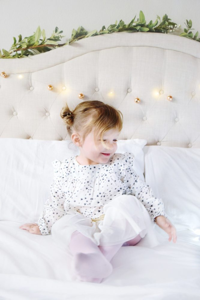 Christmas Pictures indoors with twinkle lights and bed