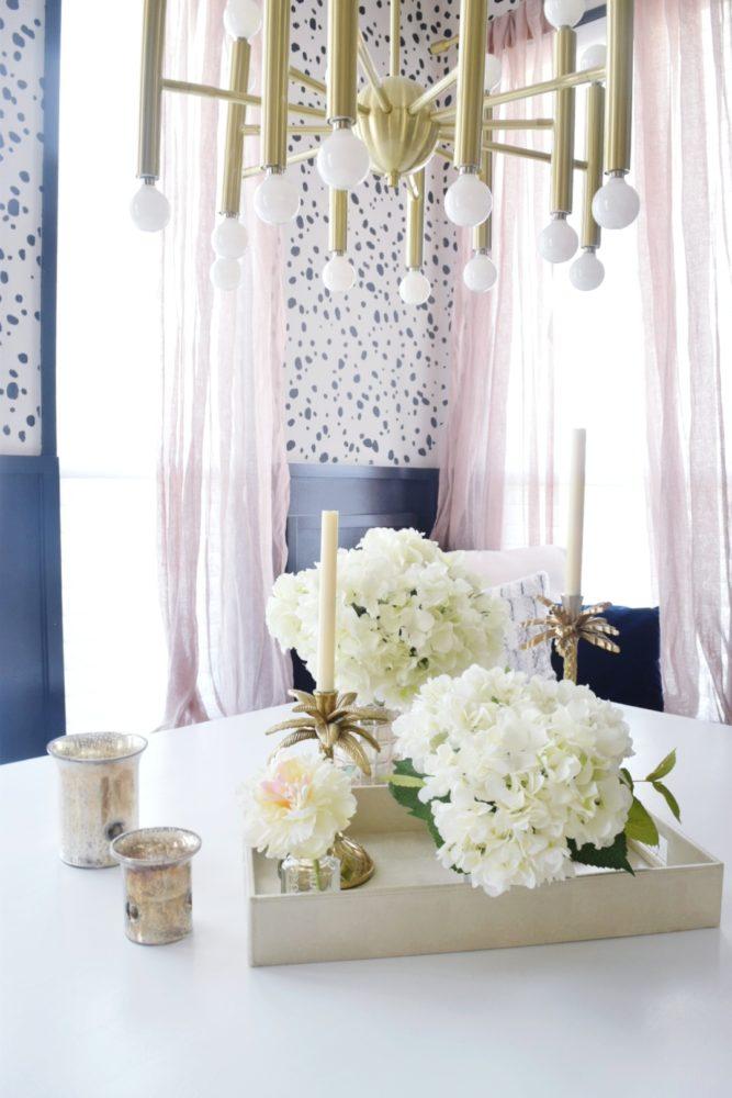 Breakfast nook makeover reveal kitchen nook kitchen decor modern coastal design brass chandelier blush sheer curtains dalmation stenciling