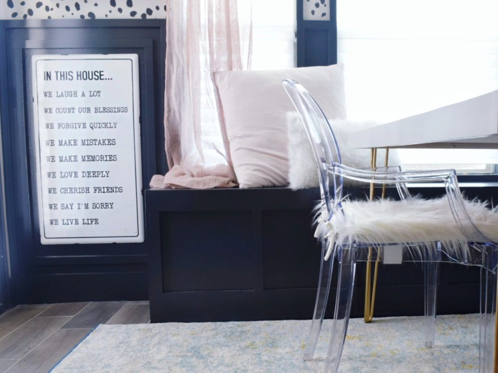 A moody modern coastal breakfast nook makeover house rules sign acrylic ghost chairs how to build a breakfast nook bench navy wall dark walls kitchen nook