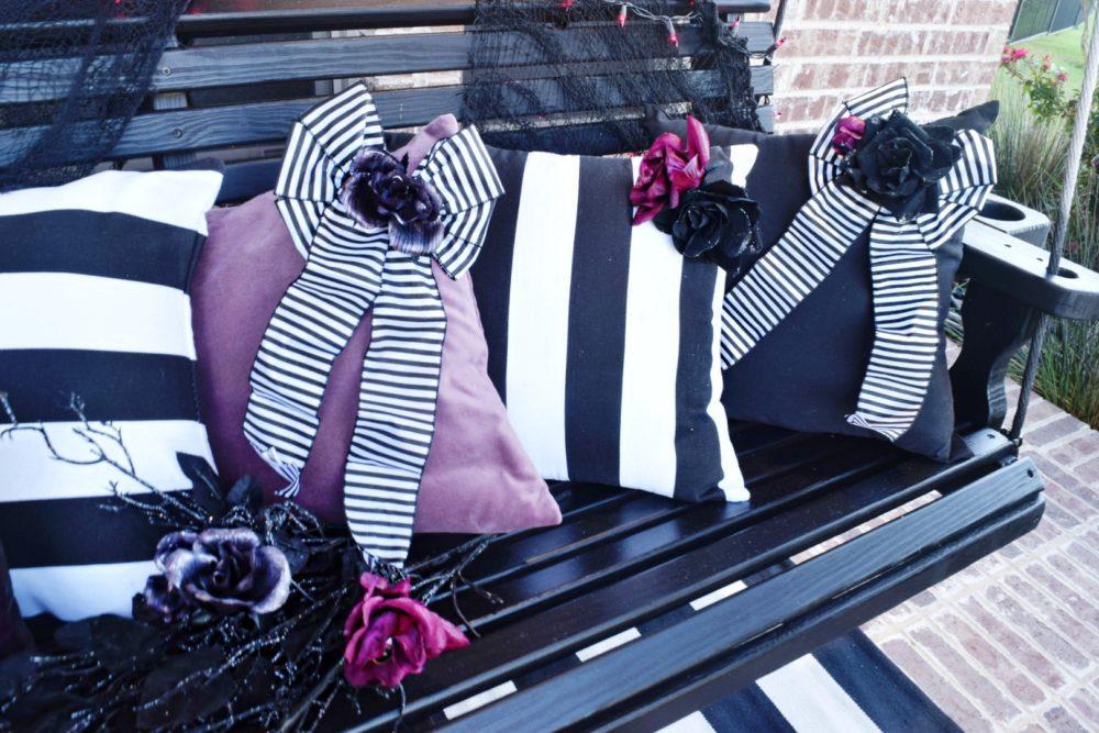 Frightful front porch modern chic halloween decorating ideas DIY flower embellishments DIY bow embellishments for pillows modern Halloween pillows