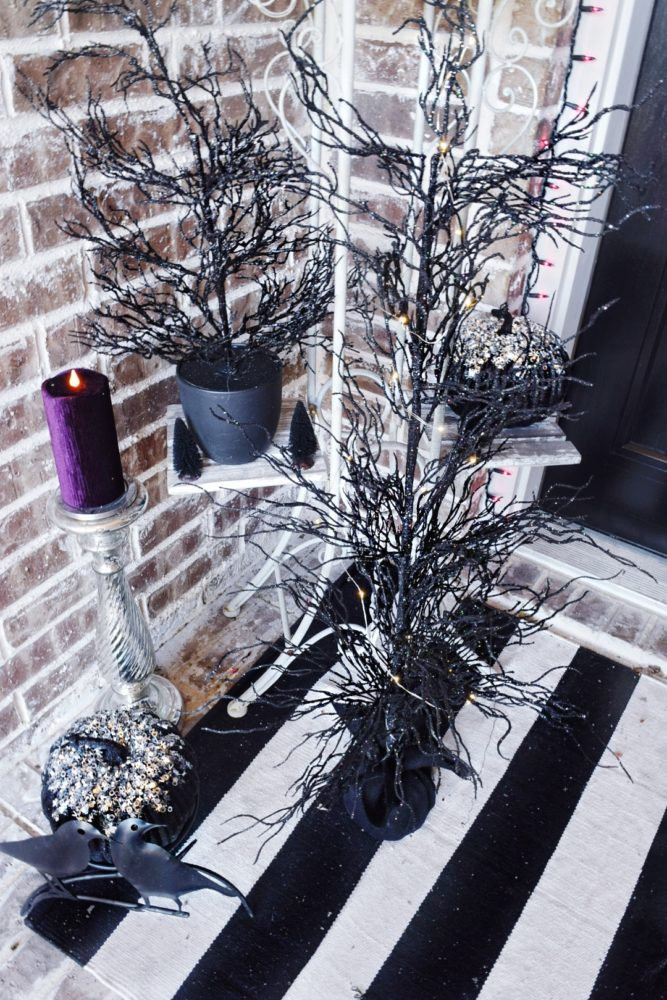 Frightful front porch modern chic halloween decorating ideas led pre lit spooky black trees purple velvet led candles how to decorate my front porch for Halloween