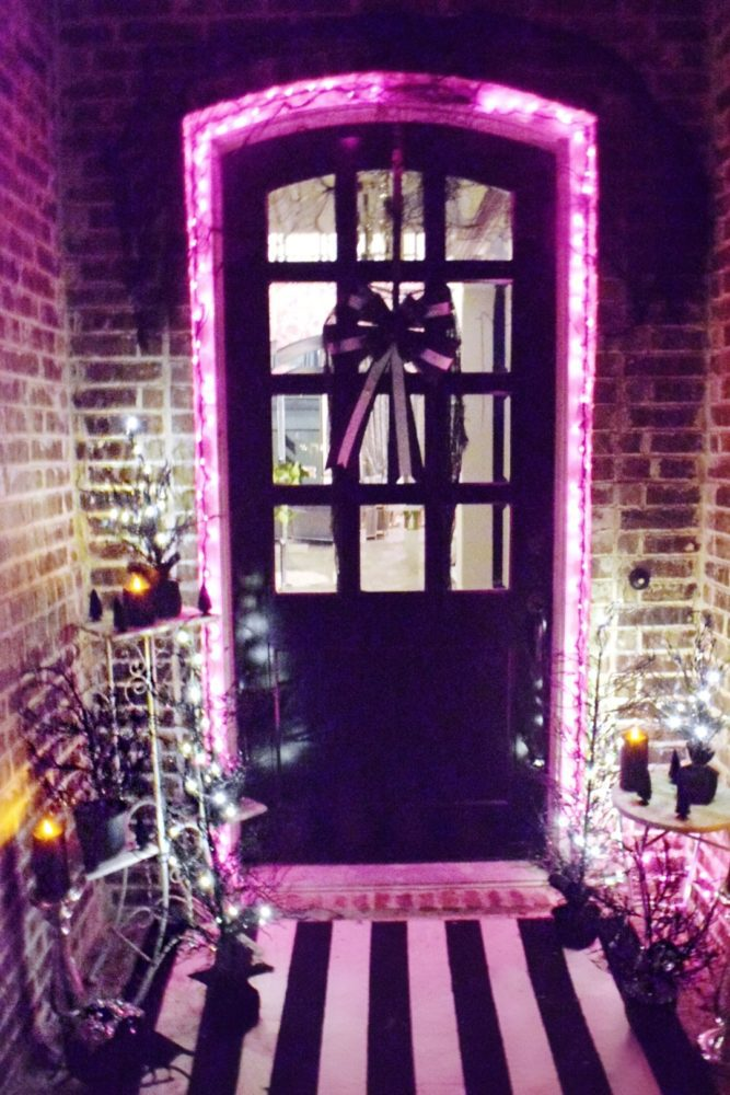 Frightful front porch pink purple halloween lights around front door