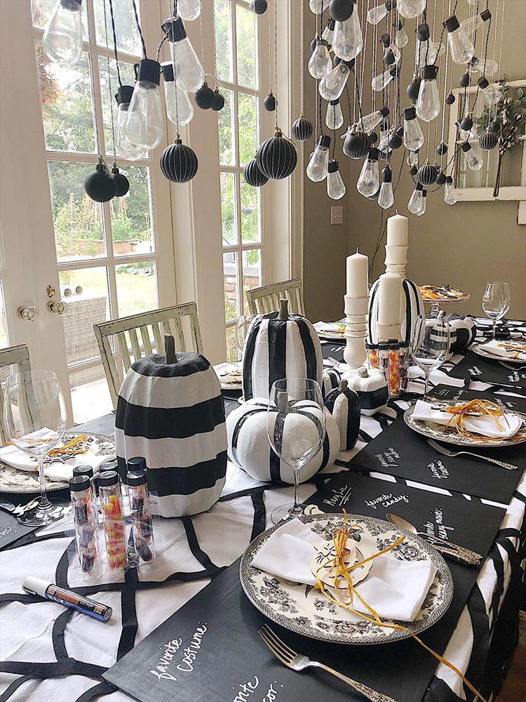 8 Creative Halloween Decorating Ideas For your Home How to Make Creative Halloween Table Decorations Black and White Pumpkins Ducktape Striped Pumpkins