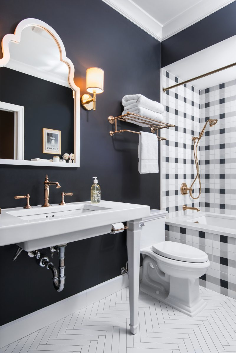 Caitlin Wilson Guest Bathroom Patterned cement floor tiles Kohler Navy and white check tile Kohler Artifacts Hotelier Kohler Artifacts Rite Temp Valve Trim Kohler Artifacts Bath Spout Kohler Forte Handshower Kohler Awaken Shower Hose
