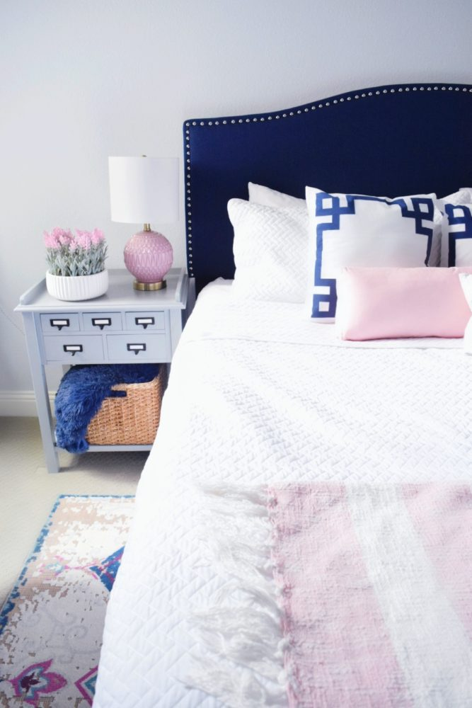 Modern Elegance Guest Bedroom Design ideas using navy and blush modern color palettes for guest bedroom decor ideas vintage bedroom rug with white bedding and greek key throw pillows