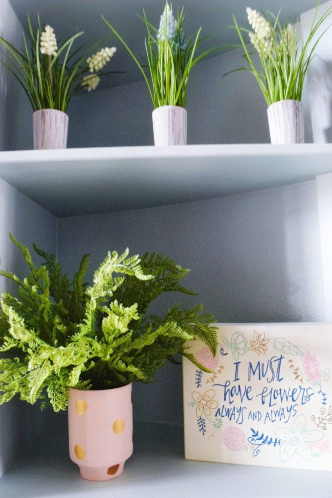 spring home decor ideas for your entryway with faux plants and flowers