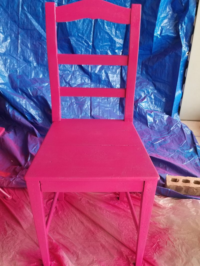 spray painting a pink chair