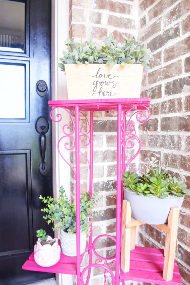 bright pink patio furniture with plants on front porch