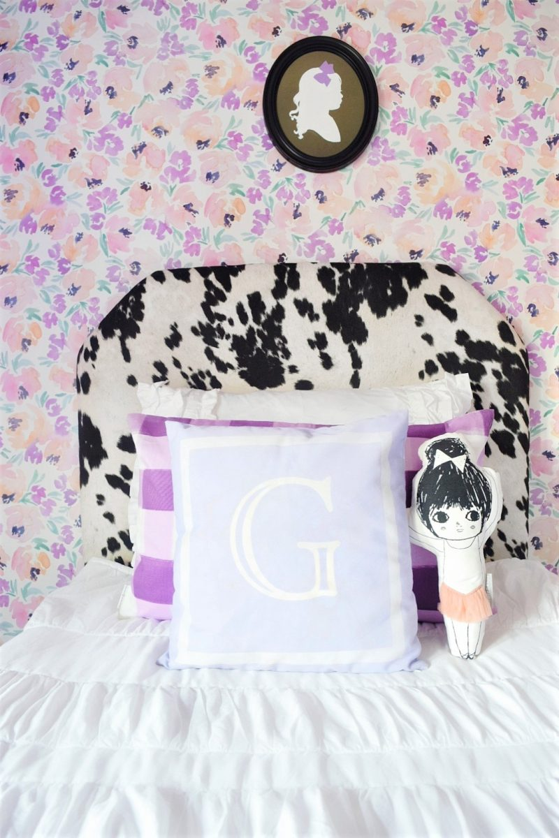 whimsical chic little girls room with peony wallpaper monogram pillow and black cowhide headboard