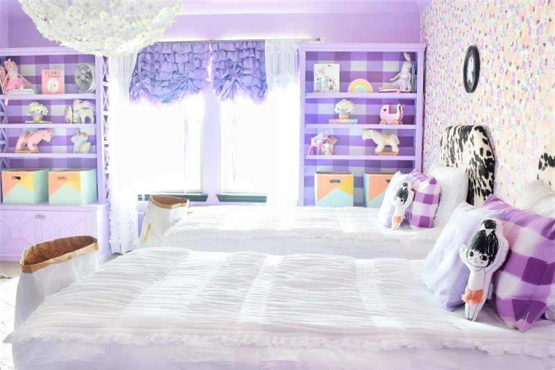 twin girls bedroom with light purple walls and floral wallpaper