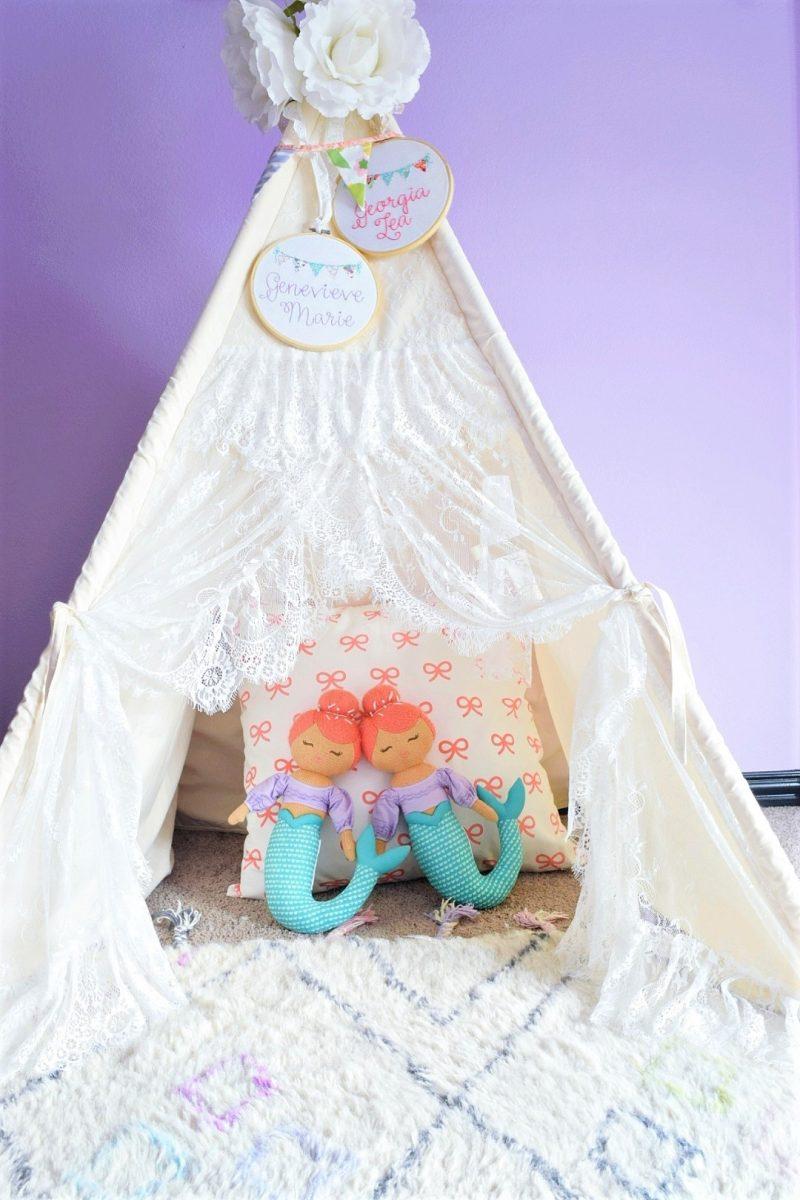little girls bedroom teepee tent with mermaid dolls