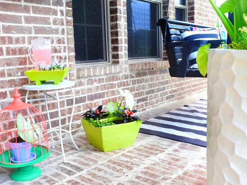 front porch with colorful furniture and plants