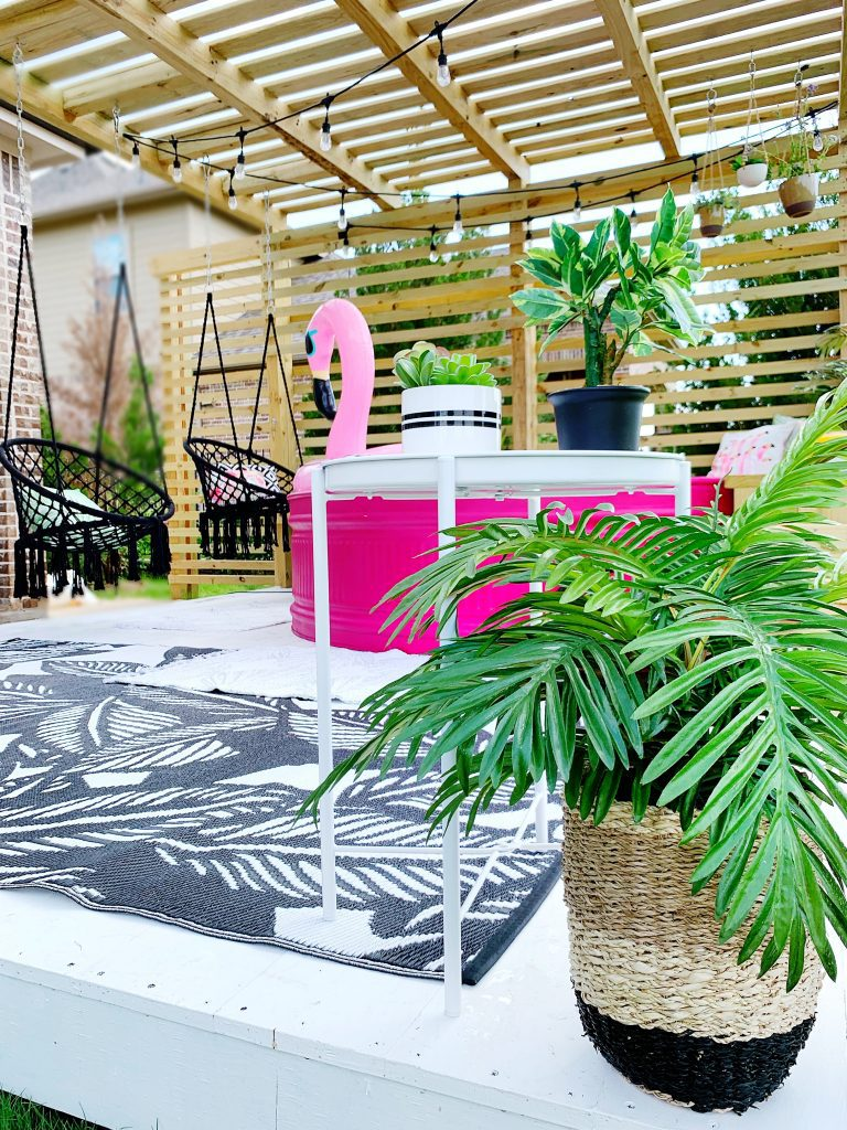 Summer Decor Accents on Deck Patio with Pink Stocktank Pool and Outdoor Decor