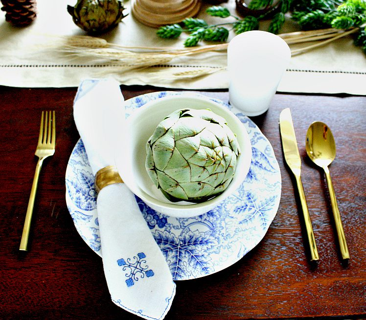 classy blue and white fall tablescape with green artichoke and chinoiserie china