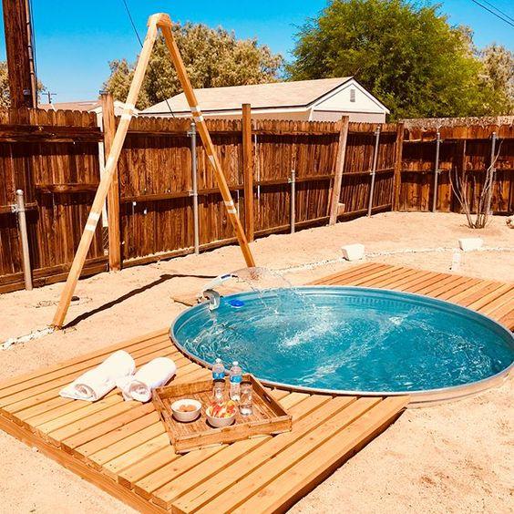 joshua tree air bnb white cactus house desert living underground stock tank pool DIY