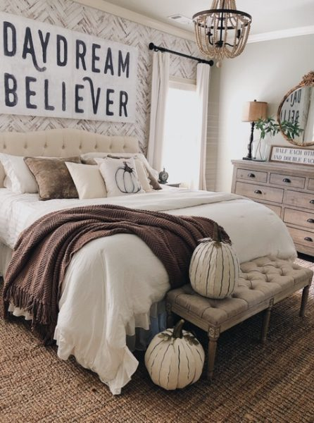 Fall Farmhouse Bedroom Decor wuth cozy chunky blankets and white pumpkins