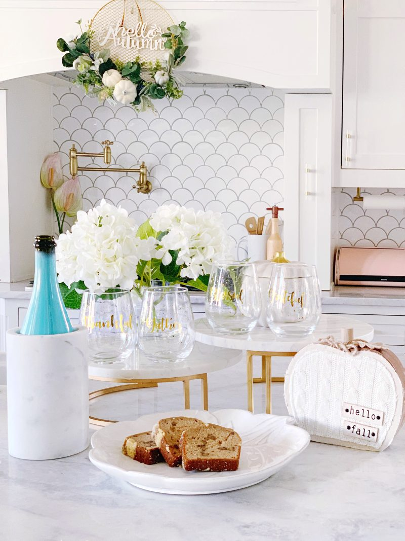 white kitchen cabinets and kitchen backsplash with white and gold fall decor
