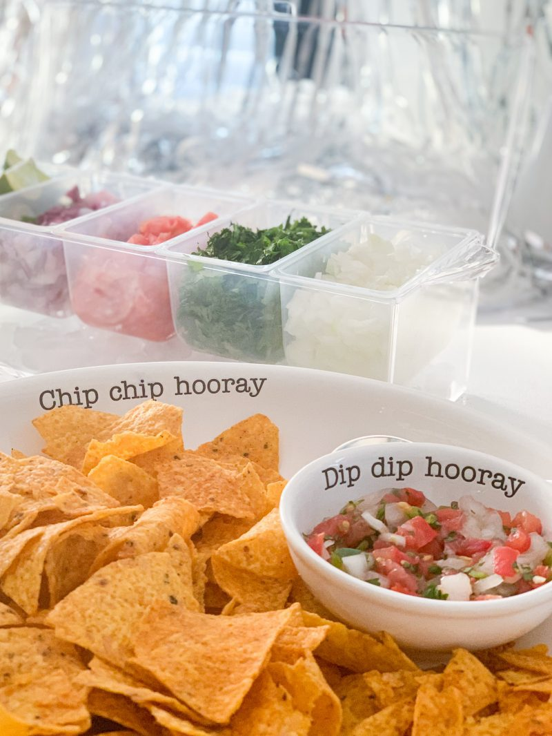 taco bar with taco toppings for best football homegating party