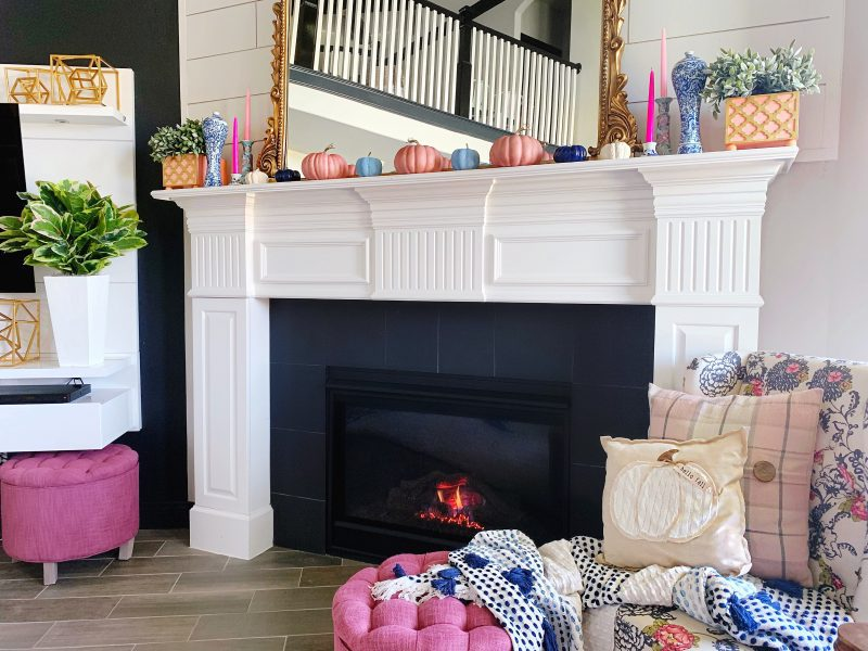 modern fall mantle with pink and blue fall color palette pink and blue pumpkins