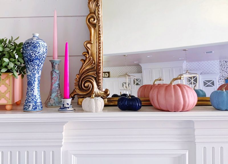 modern fall mantle with pink pumpkins pink taper candles and chinoiserie vase