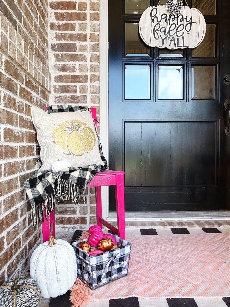 colorful fall front porch with black and white buffalo check