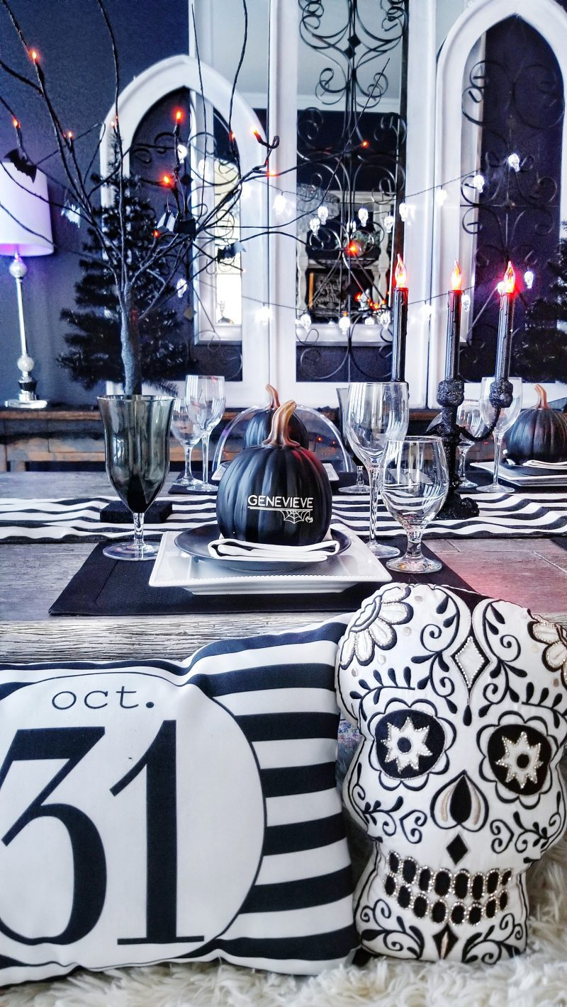 halloween dinner party with black and white striped napkins and placemats and black and white halloween pillows