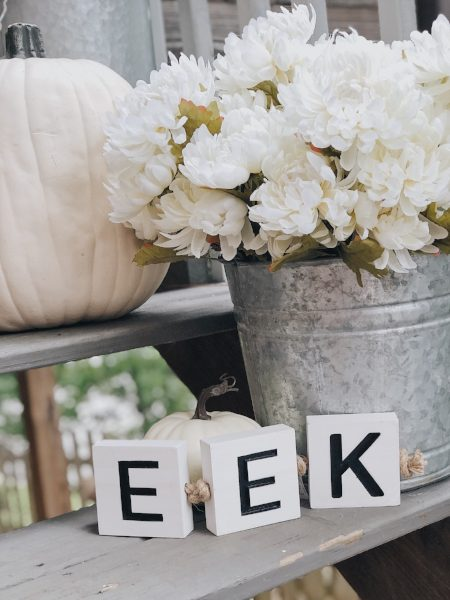 eek block white pumpkins and white mums for halloween porch