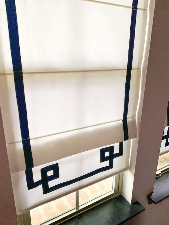 greek key trim roman shades in navy and white