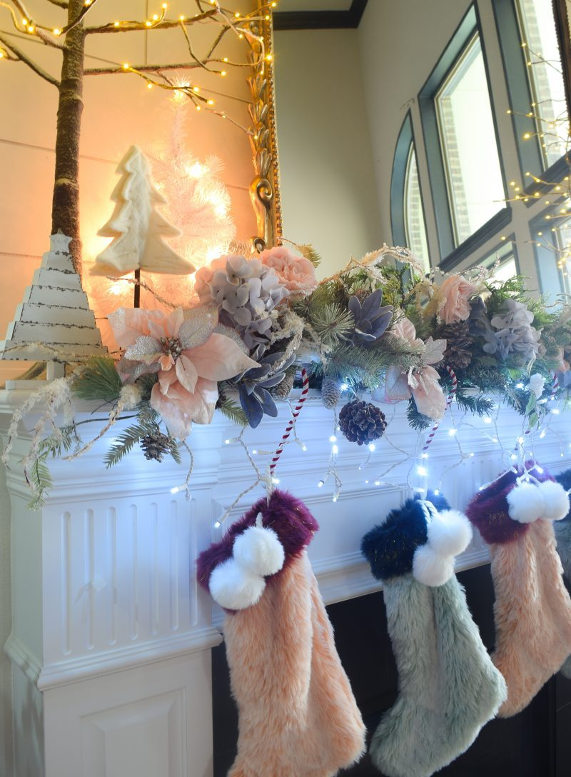fur christmas stockings and christmas garland on mantel