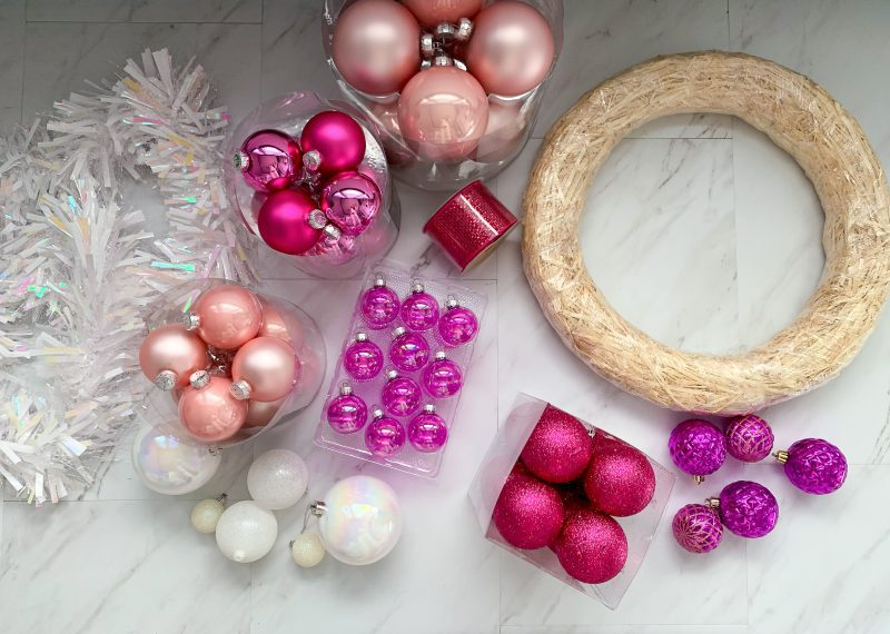 pink christmas ornaments and wreath
