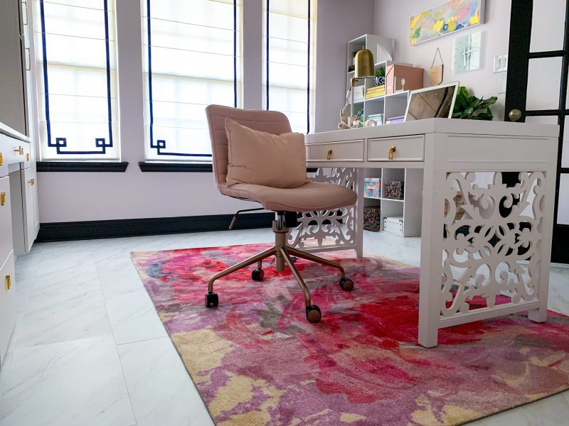 pink floral rug white modern desk in home office