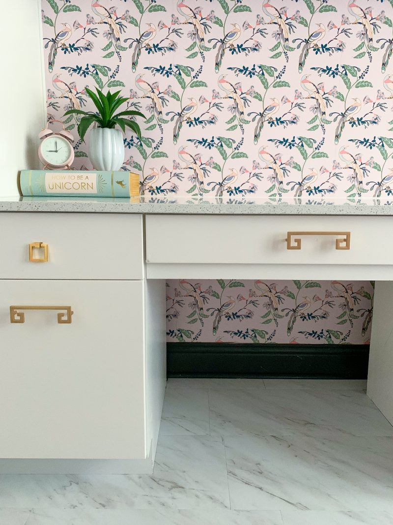 white cabinets with brass hardware pink chinoiserie wallpaper