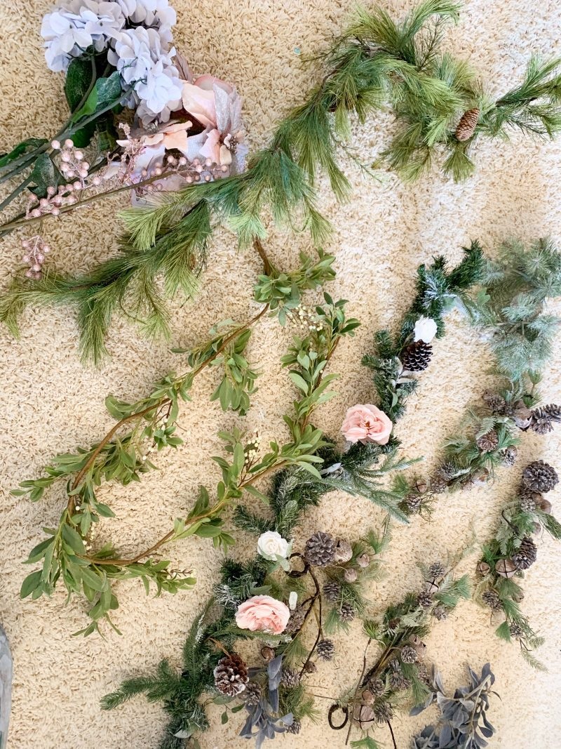 christmas garland and christmas floral stems for holiday mantel