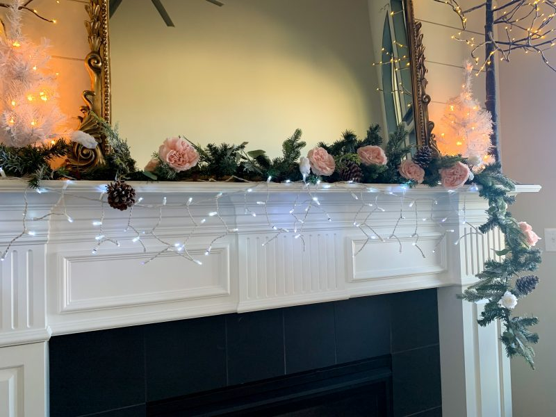 christmas fireplace mantel adding garland