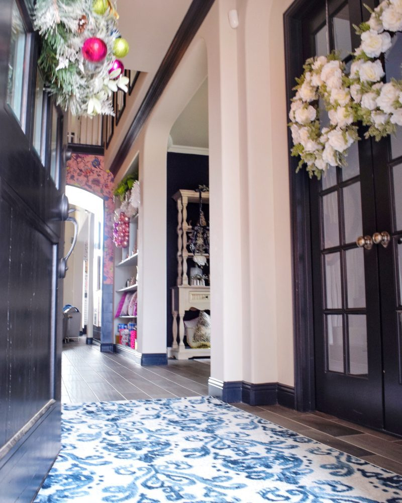 entryway holiday decor with blue and white rug