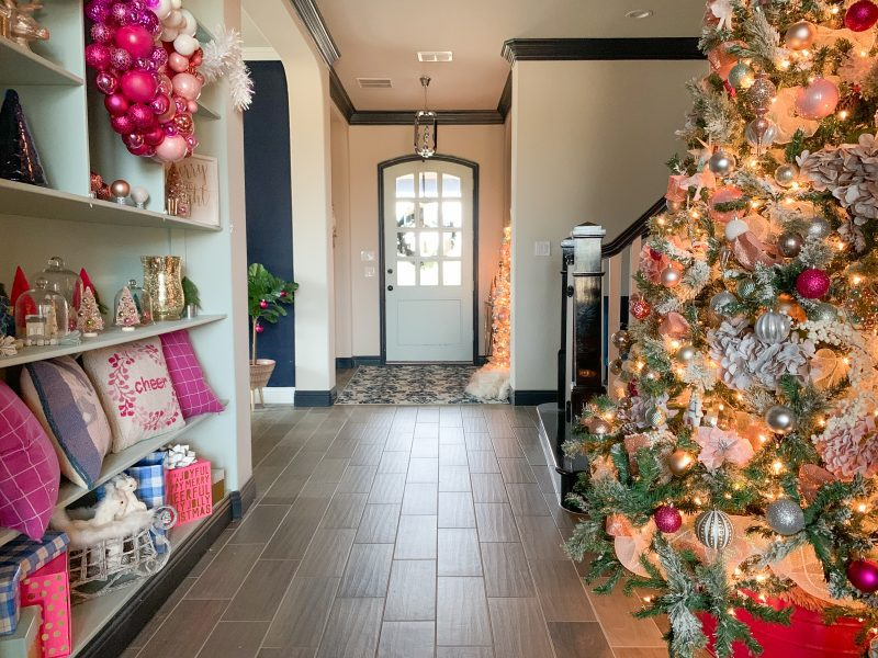 pink christmas decor on christmas tree and entryway