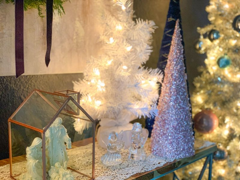 christmas tree and manger scene on entryway table