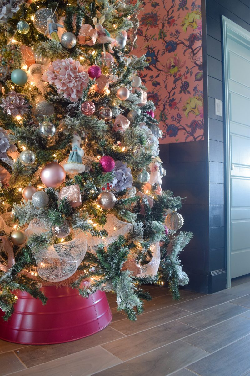 christmas tree with pink white blue christmas ornaments and pink tree collar