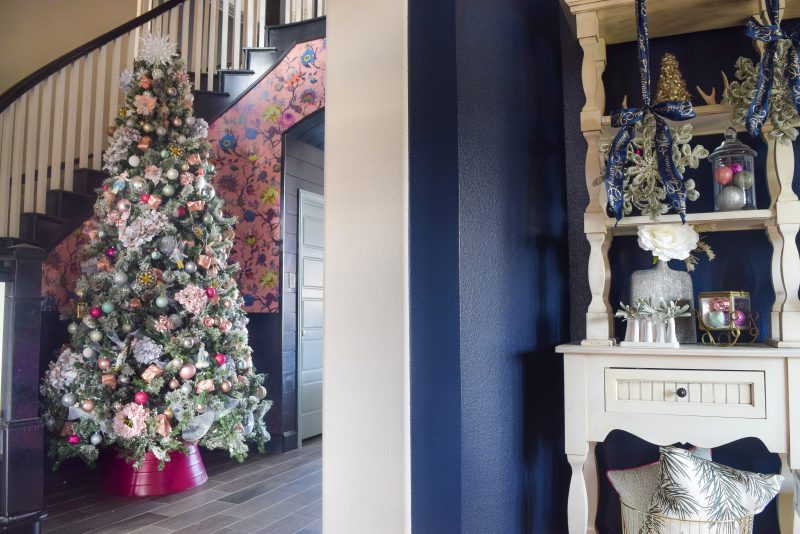 pink christmas tree decor with pink floral wallpaper backdrop