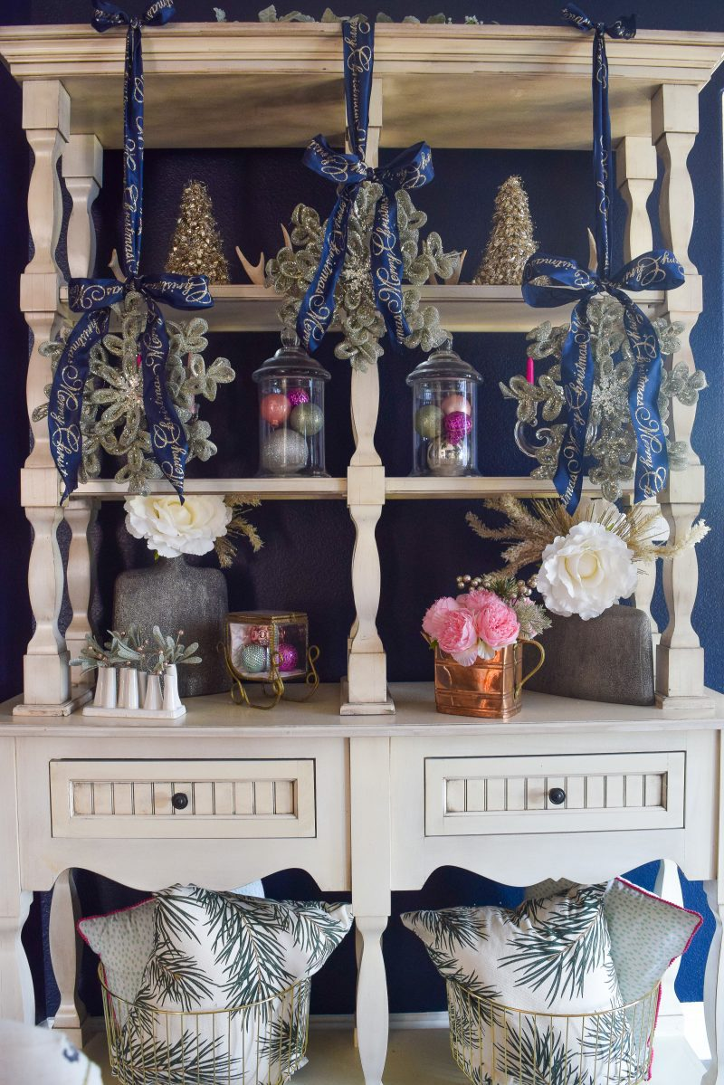 navy wall white display piece in dining room with navy and pink christmas decorations