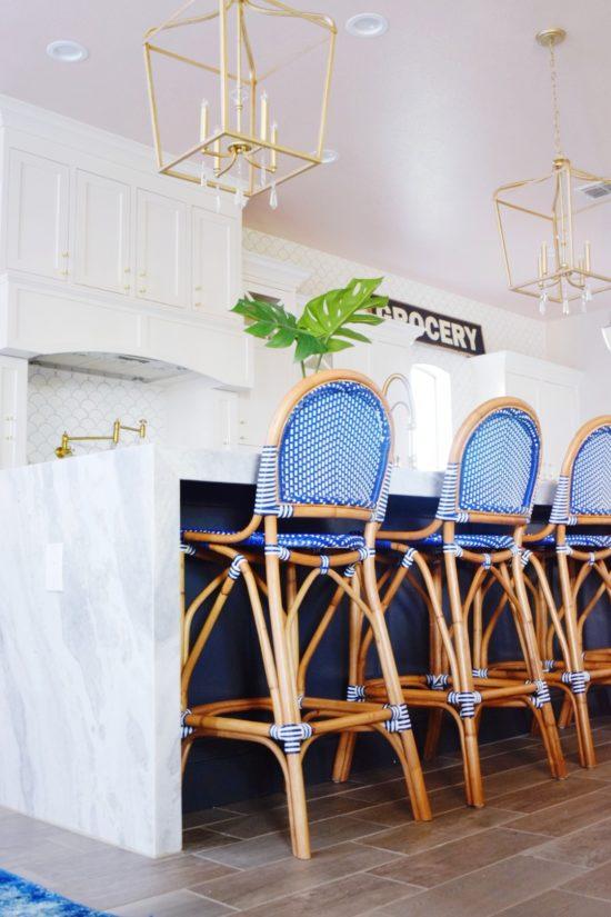 Modern Coastal Kitchen Makeover Hi Gloss Blush Pink Ceiling Gold Lantern Pendant Lights Waterfall Marble Island Blue Bistro Chairs