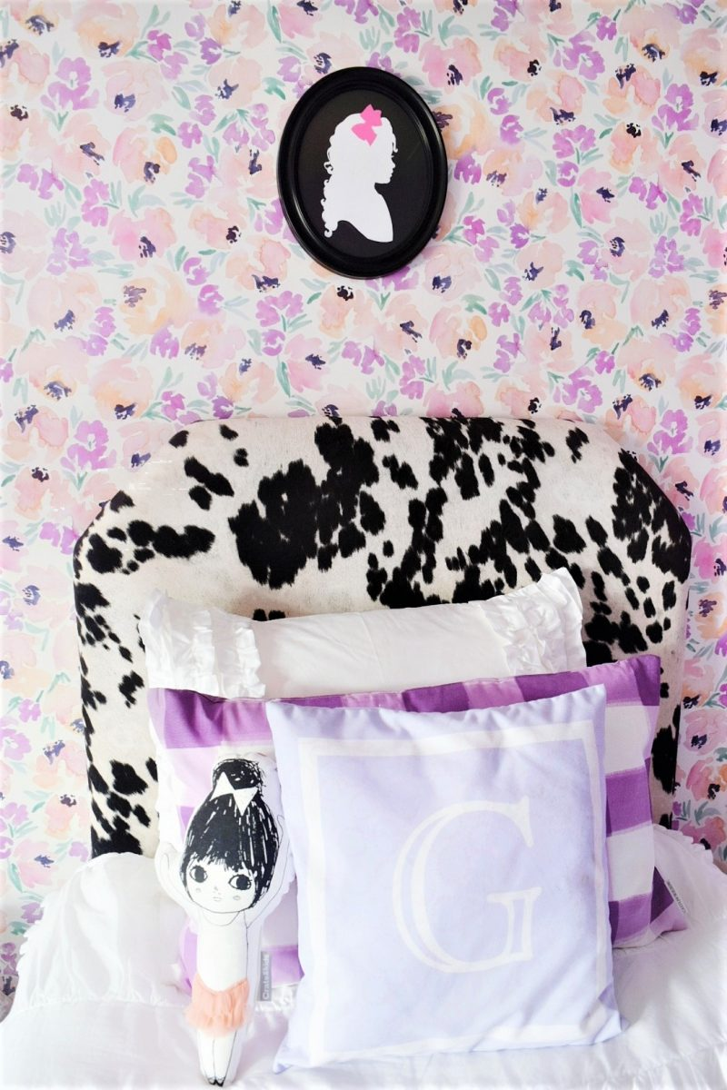 silhouette frame cowhide headboard caitlin wilson flower wallpaper monogram pillow and buffalo check pillow in little girls room