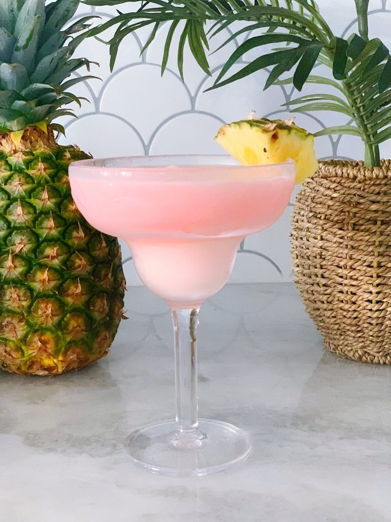 Chi Chi or chichi frozen drink in a cocktail glass with pineapple garnish