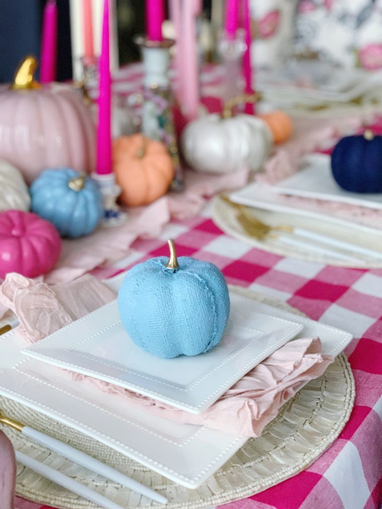 colorful fall tablescape using hot pinks apricot orange and french blue color palette pink gingham tablecloth and pink taper candle centerpiece