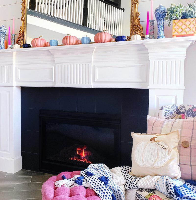 colorful fall mantle with candles and pumpkins