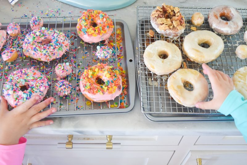 homemade donuts with cereal toppings