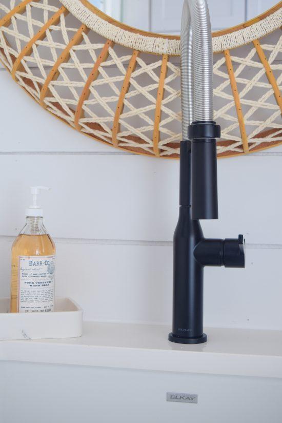 matte black faucet with shiplap walls